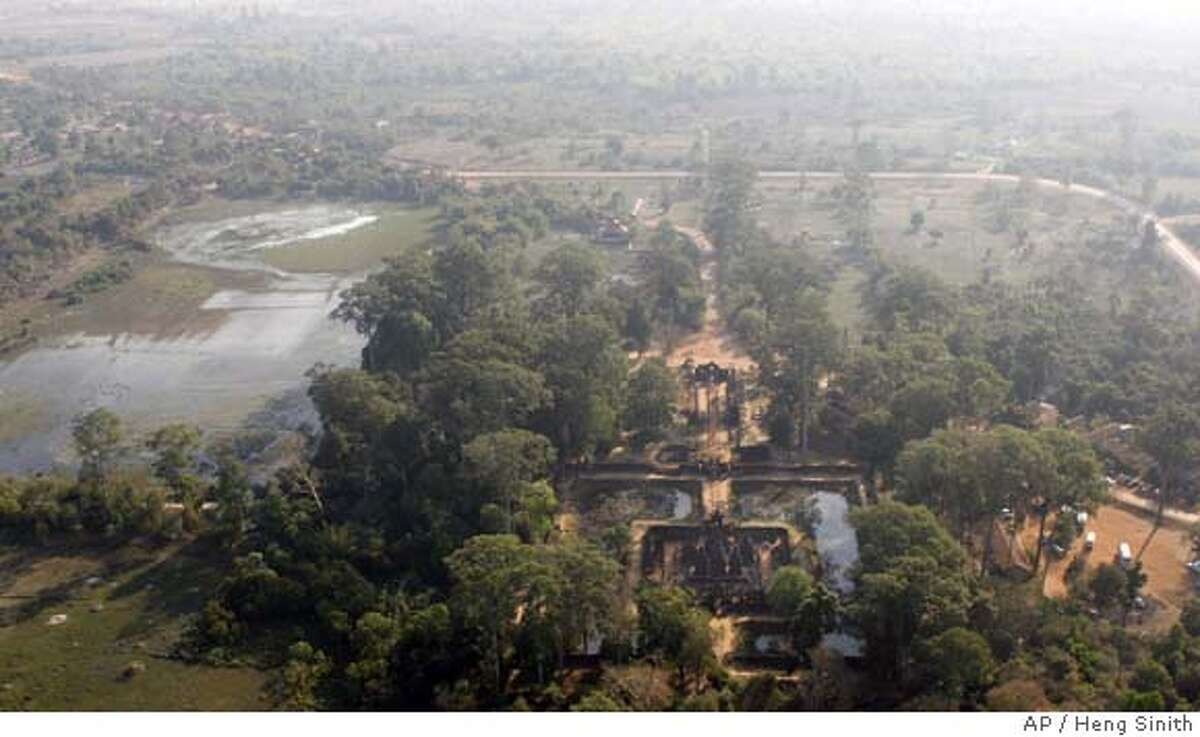 **APN ADVANCE FOR SUNDAY FEB. 17** An aerial view over Banteay Srey temple, one of the many stone monuments built during the Angkorian period, in Siem Reap province, Cambodia, on Wednesday Jan. 23, 2008. An international research group is now trying to dig up answers to the question about Angkorian hydraulic network as part its quest to shed more light on the puzzles left since the demise of the Angkor city centuries ago. (AP Photo/Heng Sinith) **APN ADVANCE FOR SUNDAY FEB. 17** PICTURE TAKEN JAN. 23, 2008