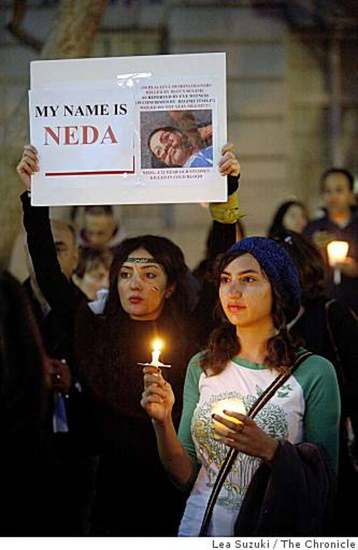 Rana Ilkan of Sunnyvale (l to r) and Golzar Afghani of San Diego, Calif. attend a vigil for Iran on Sunday June 21, 2009 in San Francisco, Calif. at U.N. Plaza.