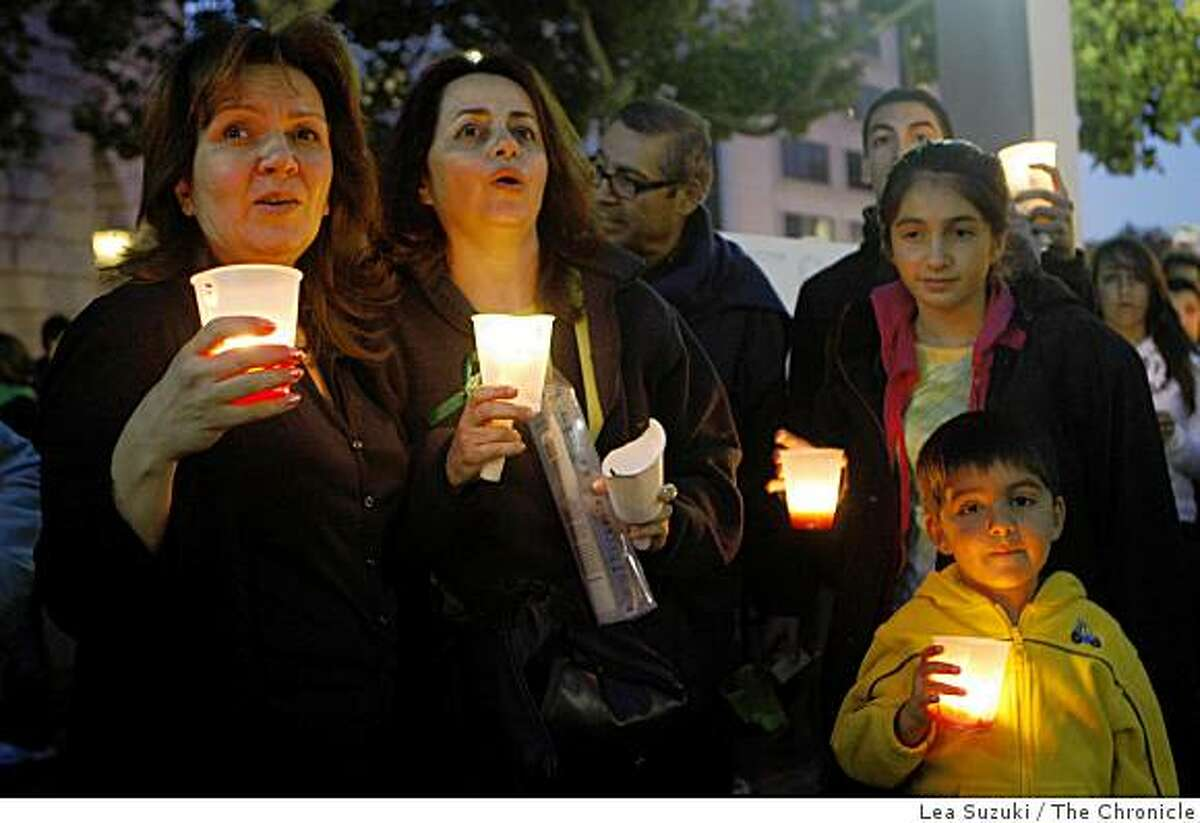 Lida B. of Moraga, Maryam M. of Alamo, Auveen M., 12, of Moraga and Nader M., 5, of Moraga sing along with others attending the vigil for Iran on Sunday June 21, 2009 in San Francisco, Calif.