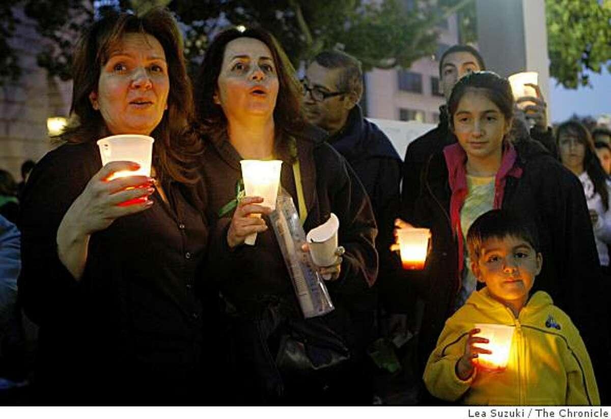 Lida B. of Moraga, Maryam M. of Alamo, Auveen M., 12, of Moraga and Nader M., 5, of Moraga sing along with others attending the vigil for Iran on Sunday June 21, 2009 in San Francisco, Calif.