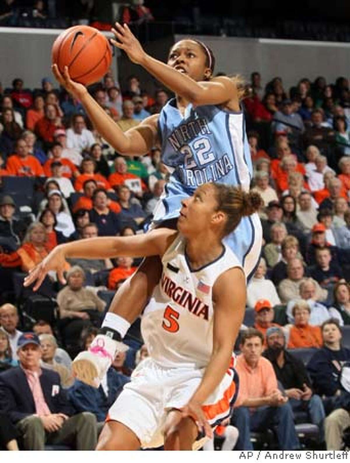 North Carolina's Cetera DeGraffenreid shoots over Virginia's Sharnee Zoll during the first half a basketball game Friday, Feb. 15, 2008, in Charlottesville, Va. (AP Photo/Andrew Shurtleff) EFE OUT