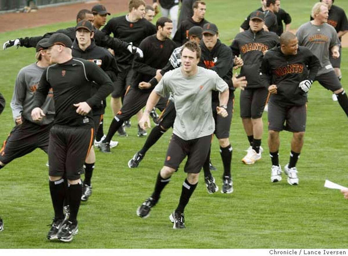 San Francisco Giants pitchers and catchers take part in running and stepping drills in the outfield at Scottsdale Stadium during their spring training baseball workout in Scottsdale, Ariz, Saturday By Lance Iversen/The San Francisco Chronicle MANDATORY CREDIT PHOTOG AND SAN FRANCISCO CHRONICLE/NO SALES MAGS OUT