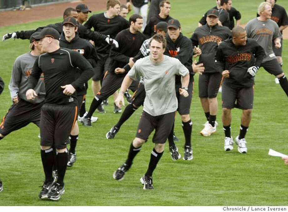 San Francisco Giants pitchers and catchers take part in running and stepping drills in the outfield at Scottsdale Stadium during their spring training baseball workout in Scottsdale, Ariz, Saturday By Lance Iversen/The San Francisco Chronicle MANDATORY CREDIT PHOTOG AND SAN FRANCISCO CHRONICLE/NO SALES MAGS OUT Photo: Lance Iversen