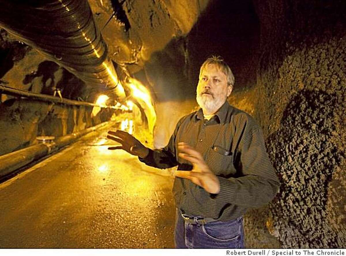 Rick Sugarek, (cq) EPA's project manager for the Iron Mountain Mine cleanup, stands inside Richmond mine portal near Redding, California, June 11, 2009. About 1,500 feet further into the mine, toxic water on the ground is strong enough to partially dissolve a shovel in less than 24 hours. Iron Mountain Mine is one of the country's most polluted and environmentally important sites, where $20 million in stimulus funds are being spent to speed the clean up of a creek feeding into the Keswick Reservoir. From the 1860s through 1963, this 4,400-acre site was mined for iron, silver, gold, copper, zinc, and pyrite. Vast contamination has lead to the elimination of aquatic life in area creeks and a steady decline in the fisheries population of the Sacramento River.