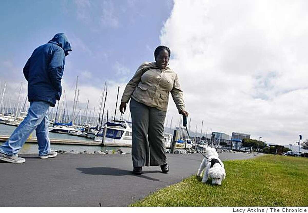 Marisha Anderson walks her dog Jack along the Emeryville Habor to