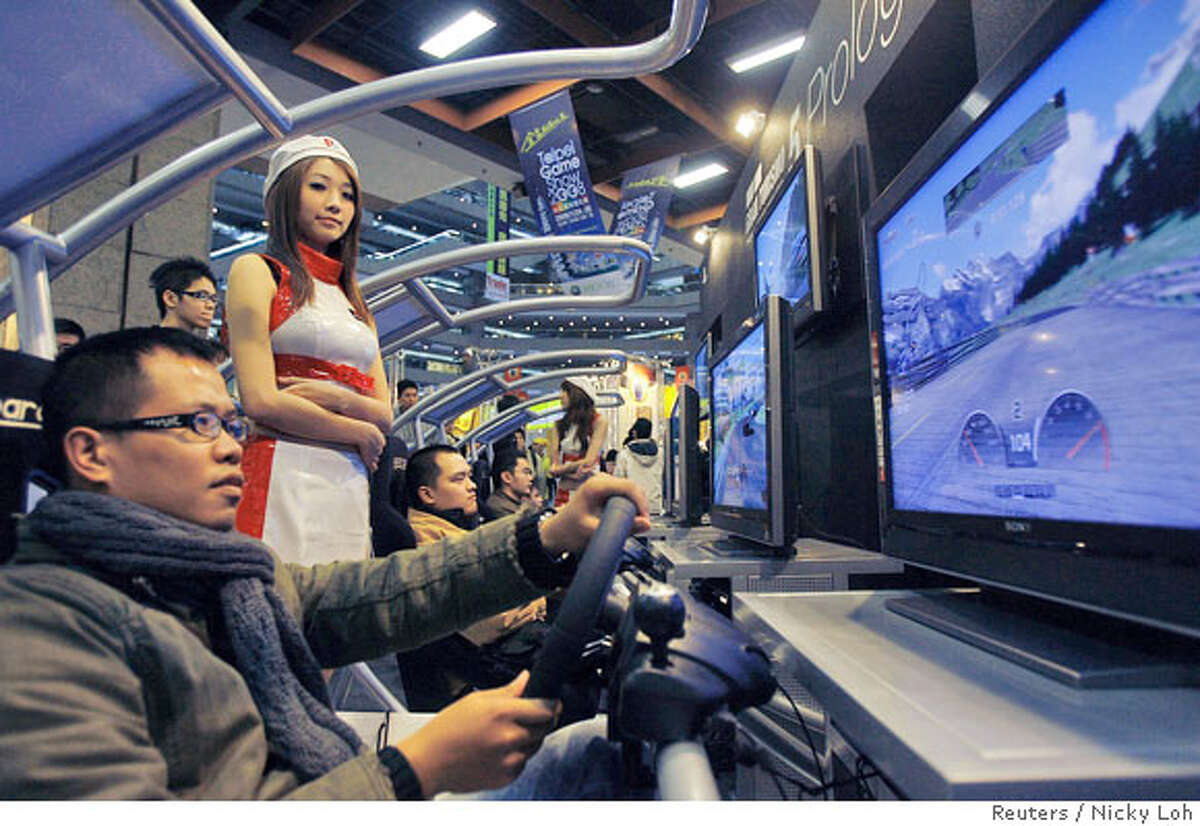 A man tries the Gran Turismo 5 Prologue Playstation 3 video game during the 2008 Taipei Game Show January 24, 2008. The computer and video games exhibition will be held in Taipei from January 24-28. REUTERS/Nicky Loh (TAIWAN)