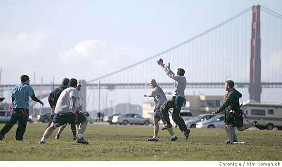 Friends gathered on the Marina Green Sunday for a pre-Super Bowl game of football. Photo by Kim Komenich/The Chronicle