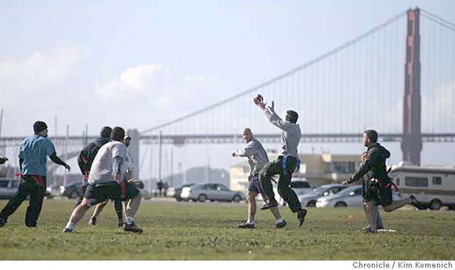 Friends gathered on the Marina Green Sunday for a pre-Super Bowl game of football.  Photo by Kim Komenich/The Chronicle Photo: KIM KOMENICH