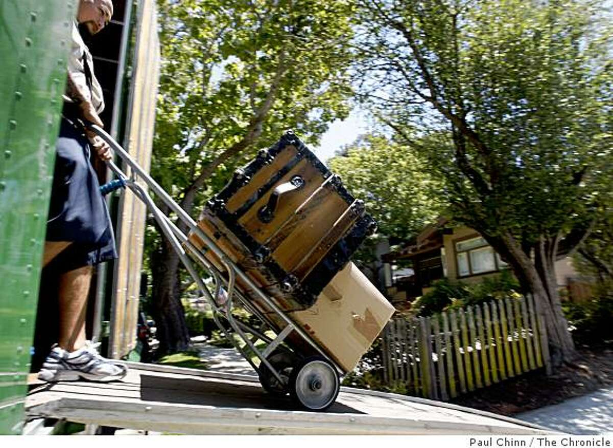 Boris Rodriguez from Cummings Moving & Storage unloads furniture at a client's home in Burlingame, Calif., on Tuesday, June 23, 2009.