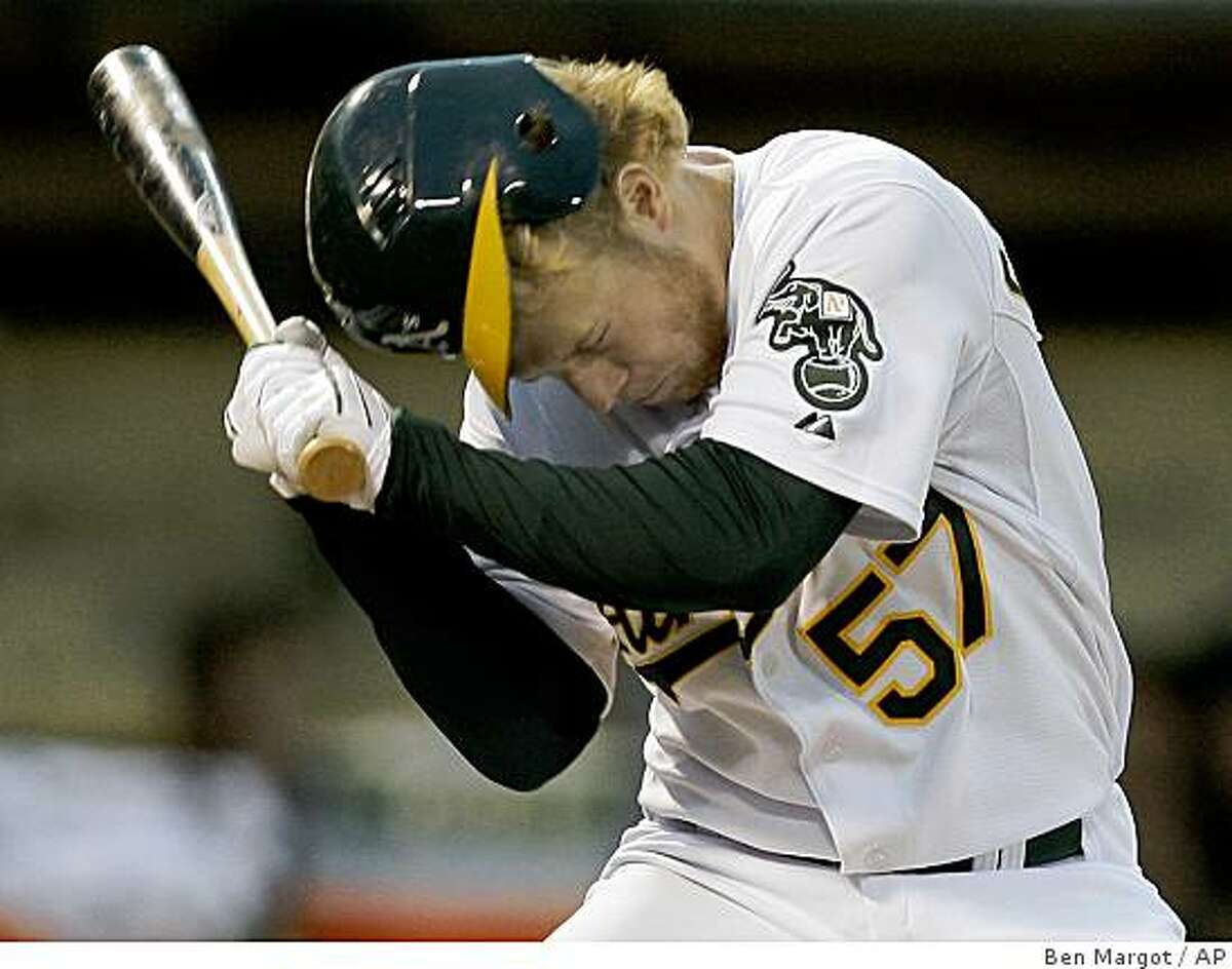 Oakland Athletics' Aaron Cunningham is hit in the head by a pitch thrown by Minnesota Twins' Anthony Swarzak in the fourth inning of a baseball game in Oakland, Calif., Monday, June 8, 2009. (AP Photo/Ben Margot)