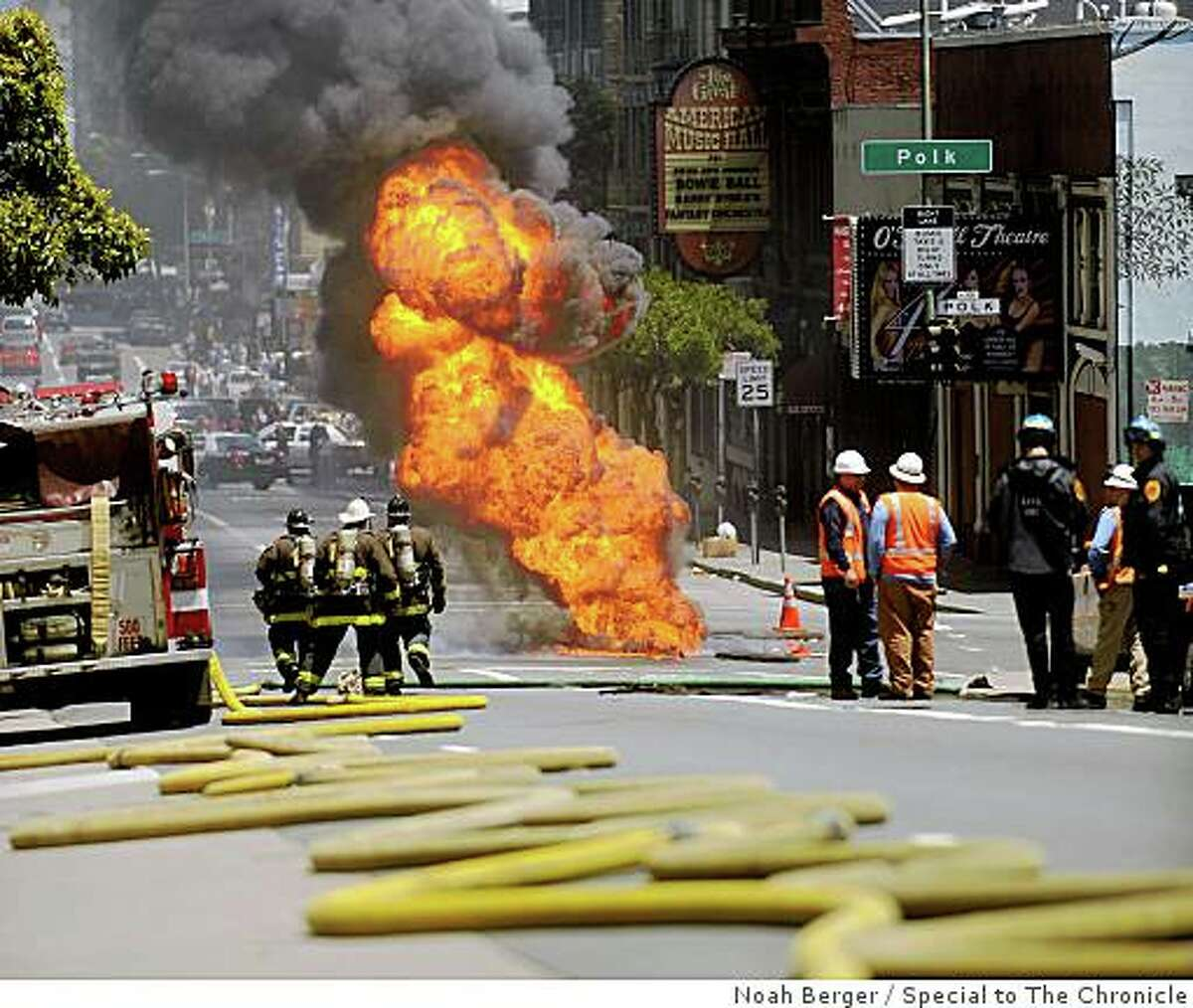 Fire pours through a manhole at Polk and O'Farrell Streets on Friday, June 5, 2009, in San Francisco.