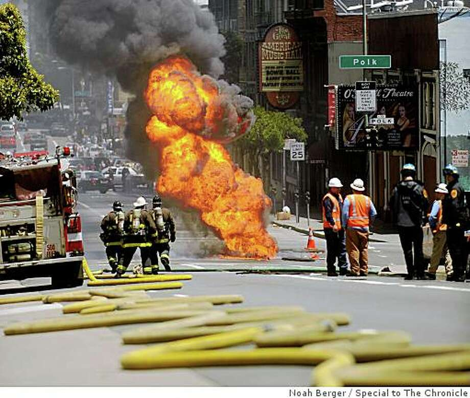 Fire pours through a manhole at Polk and O'Farrell Streets on Friday, June 5, 2009, in San Francisco. Photo: Noah Berger, Special To The Chronicle