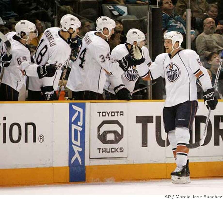 Edmonton Oilers center Kyle Brodziak, right, is congratulated by teammates after scoring against the San Jose Sharks in the second period of an NHL hockey game in San Jose, Calif., Thursday, Feb. 14, 2008.(AP Photo/Marcio Jose Sanchez) Photo: Marcio Jose Sanchez