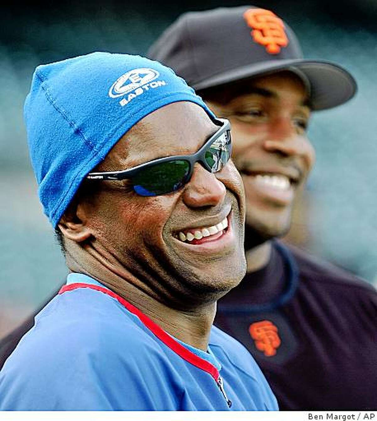 FILE - In this April 29, 2003 file photo, Chicago Cubs' Sammy Sosa, left, and San Francisco Giants' Barry Bonds smile during batting practice prior to a baseball game in San Francisco. The New York Times reported on its website Tuesday, June 16, 2009, that Sosa tested positive for a performance-enhancing drug in 2003, citing lawyers familiar with the case. The newspaper did not identify the drug. (AP Photo/Ben Margot, File)