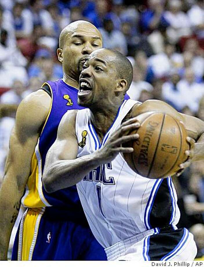 Orlando Magic's Rafer Alston (1) drives past Los Angeles Lakers' Derek Fisher in the second half of Game 3 of the NBA basketball finals Tuesday, June 9, 2009, in Orlando, Fla. Alston scored 20 points and the MAgic won 108-104. (AP Photo/David J. Phillip) Photo: David J. Phillip, AP