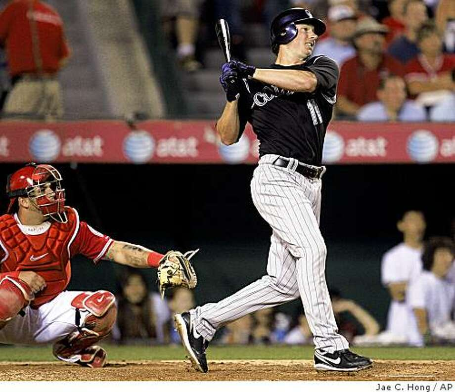 Colorado Rockies' Brad Hawpe watches the flight of his three-run home run against the Los Angeles Angels in the fifth inning of a baseball game in Anaheim, Calif., Monday, June 22, 2009. (AP Photo/Jae C. Hong) Photo: Jae C. Hong, AP