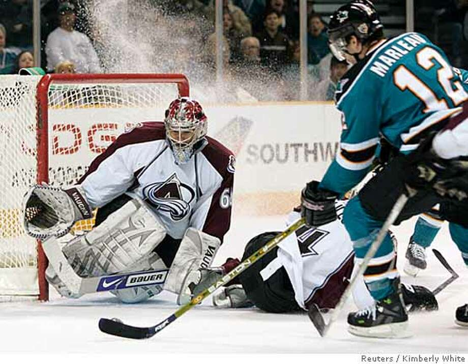 San Jose Sharks Patrick Marleau (R) attempts a shot past Colorado Avalanche goaltender Jose Theodore in the second period of their NHL hockey game in San Jose, California, February 6, 2008. REUTERS/Kimberly White (UNITED STATES)  Ran on: 02-07-2008  San Jose's Patrick Marleau has a shot attempt blocked by Avalanche goalie Jose Theodore in the second period.  Ran on: 02-07-2008  San Jose's Patrick Marleau has a shot attempt blocked by Avalanche goalie Jose Theodore in the second period. Photo: KIMBERLY WHITE