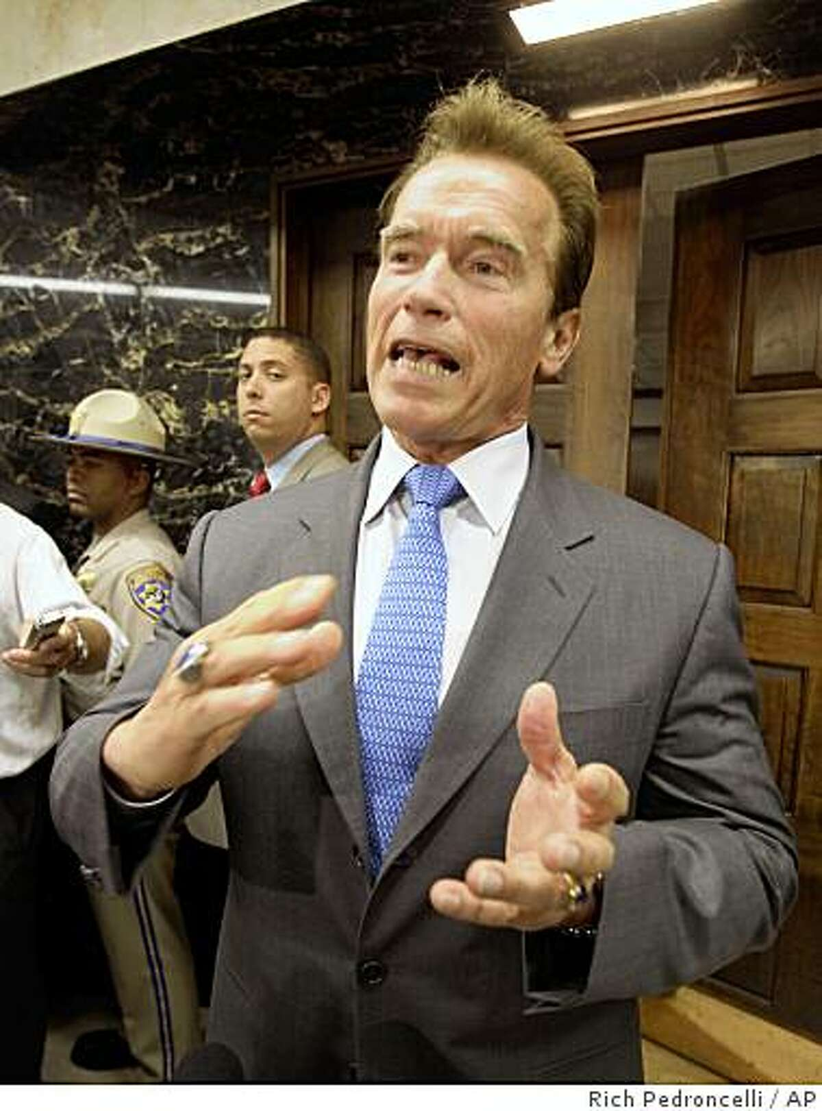 Gov. Arnold Schwarzenegger said that he would veto any budget bill that includes new taxes beyond what he has already proposed, while talking to reporters about the state budget outside his Capitol office in Sacramento, Calif., Wednesday, June 17, 2009.(AP Photo/Rich Pedroncelli)