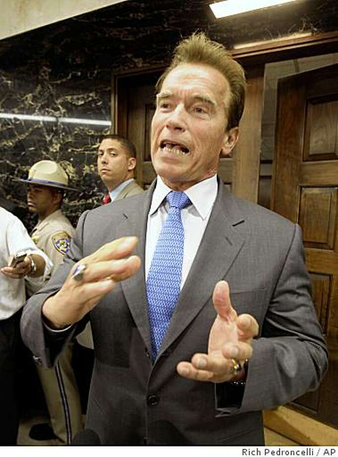 Gov. Arnold Schwarzenegger said that he would veto any budget bill that includes new taxes beyond what he has already proposed, while talking to reporters about the state budget outside his Capitol office in Sacramento, Calif., Wednesday, June 17, 2009.(AP Photo/Rich Pedroncelli) Photo: Rich Pedroncelli, AP