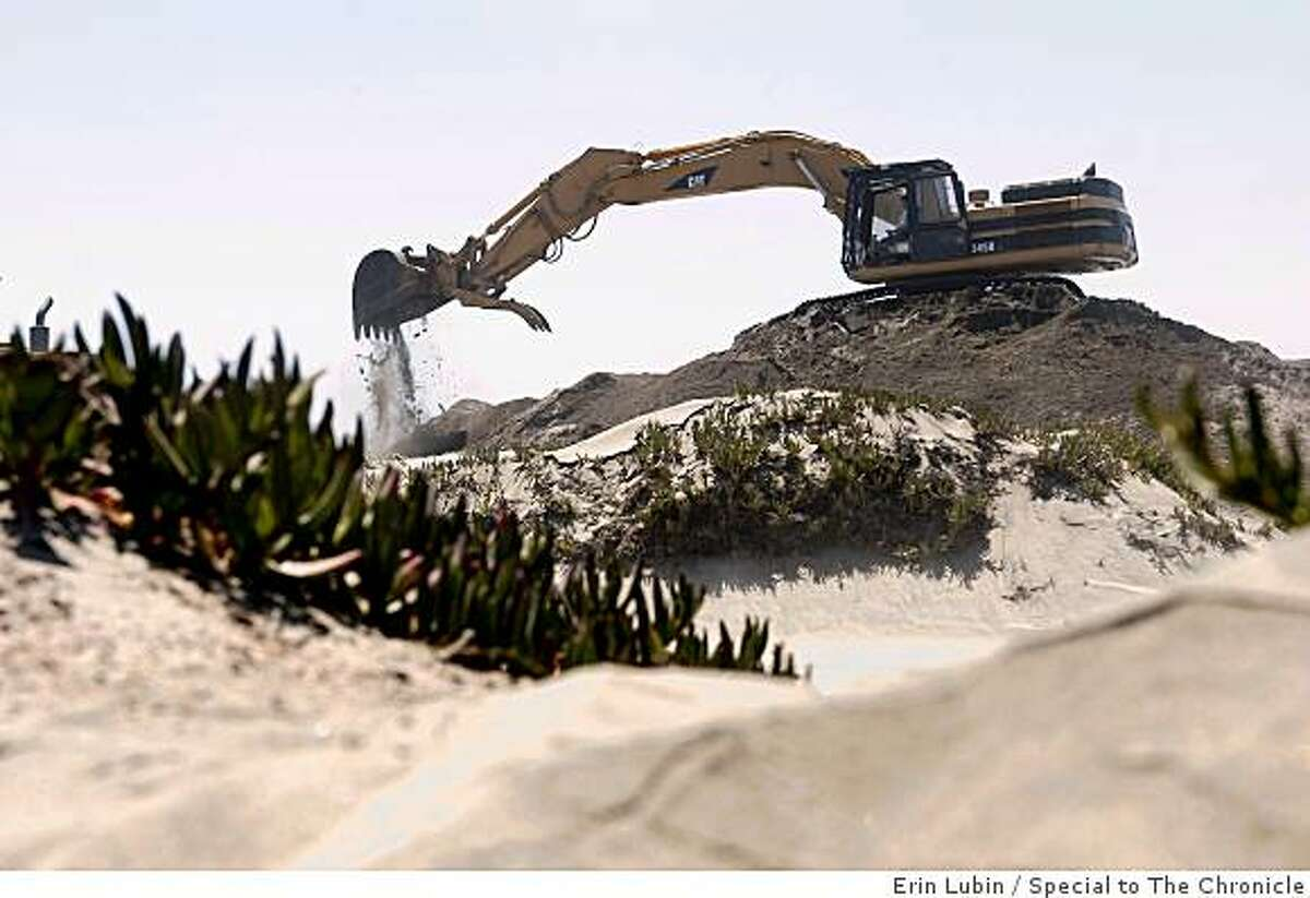 San Francisco Public Works crews remove sand from the Great Highway in San Francisco, Calif. on Monday, June 22, 2009. The Public Works department is scheduled to begin their annual sand clean-up project at the Great Highway tomorrow.
