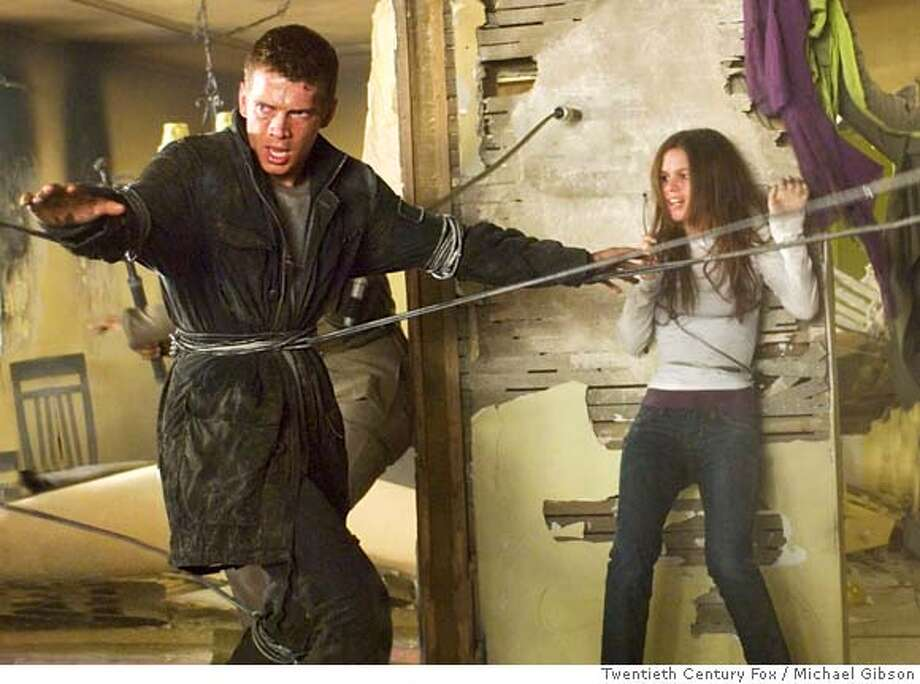 In this image released by Twentieth Century Fox, Hayden Christensen, left, and Rachel Bilson are shown in a scene from the film, Jumper. (AP Photo/Twentieth Century Fox, Michael Gibson) ** NO SALES ** IMAGE RELEASED BY TWENTIETH CENTURY FOX. NO SALES. AP PROVIDES ACCESS TO THIS PUBLICLY DISTRIBUTED HANDOUT PHOTO. THE COPYRIGHT IS OWNED BY A THIRD PARTY. AP provides access to this publicly distributed HANDOUT photo to be used only to illustrate news rep Photo: Michael Gibson