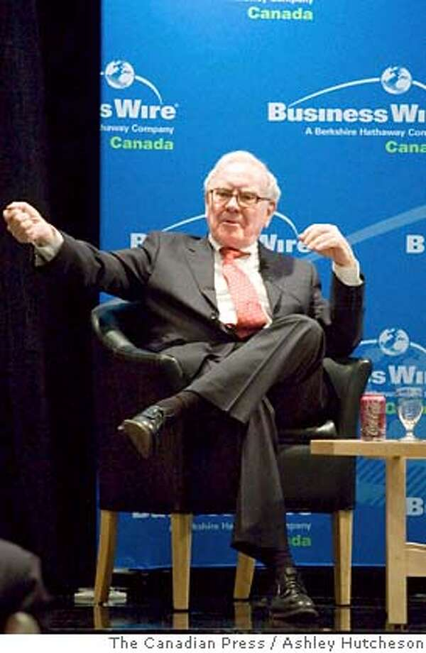 Warren Buffett, chairman of Berkshire Hathaway, Business Wires parent company, speaks at the Toronto Board of Trade in Toronto, on Wednesday Feb. 6, 2008, to mark the opening of Business Wires expansion into Canada. (AP Photo/The Canadian Press, Ashley Hutcheson. Photo: Ashley Hutcheson