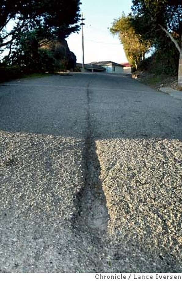 City officials claim Brewster Drive between Buckingham Dr and Devonshire Drive is one of the worst for potholes and cracks. The City of El Cerrito is asking it's voters to approve a half-cent sales tax on the Feb 5th ballet that will fix many of the cities potholes and cracked asphalt streets. By Lance Iversen/The Chronicle MANDATORY CREDIT PHOTOG AND SAN FRANCISCO CHRONICLE/NO SALES MAGS OUT Photo: Lance Iversen