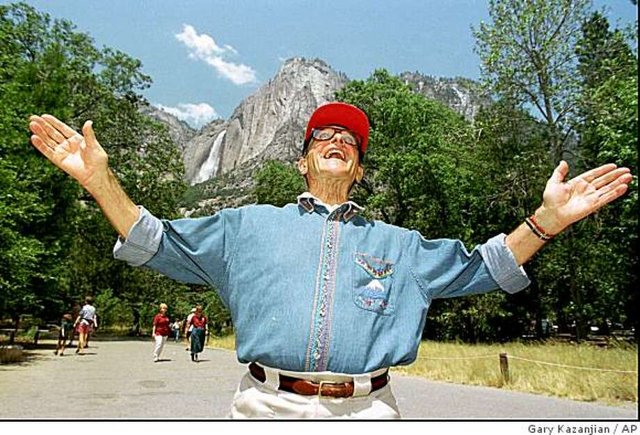 Nic Fiore gestures while standing in front of Yosemite Falls in Yosemite National Park, Calif., Friday July 24, 1998. Photo: Gary Kazanjian, AP