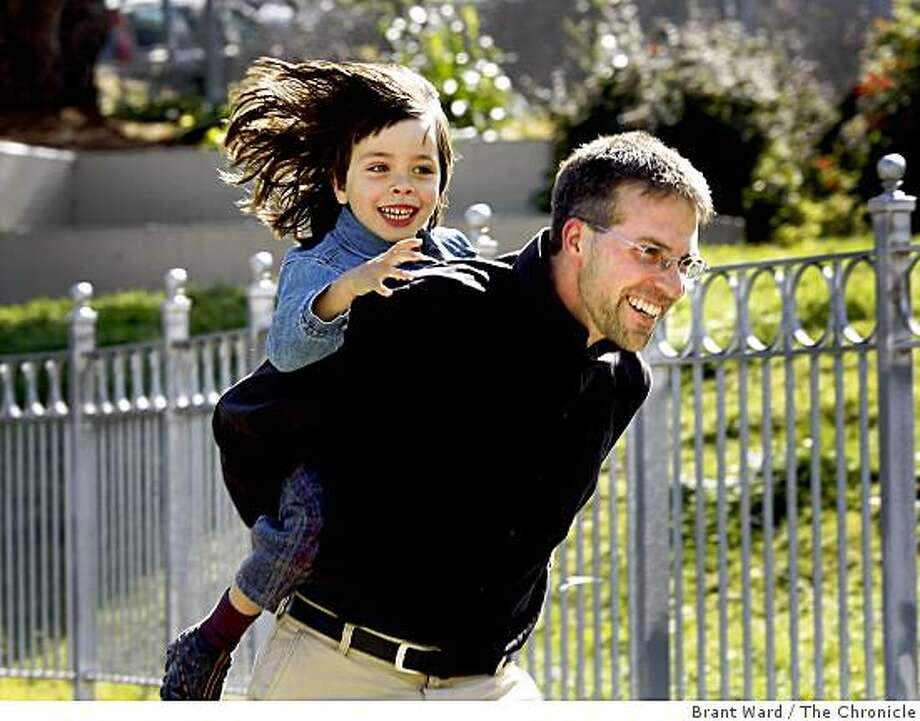 "Smith runs with his son at a Noe Valley park close to his home. San Francisco author Jeremy Adam Smith has a book called ""The Daddy Shift: How Stay-at-Home Dads, Breadwinning Moms and Shared Parenting Are Transforming the Twenty-First-Century Family"" coming out Tuesday June 2, 2009. Photo: Brant Ward, The Chronicle"