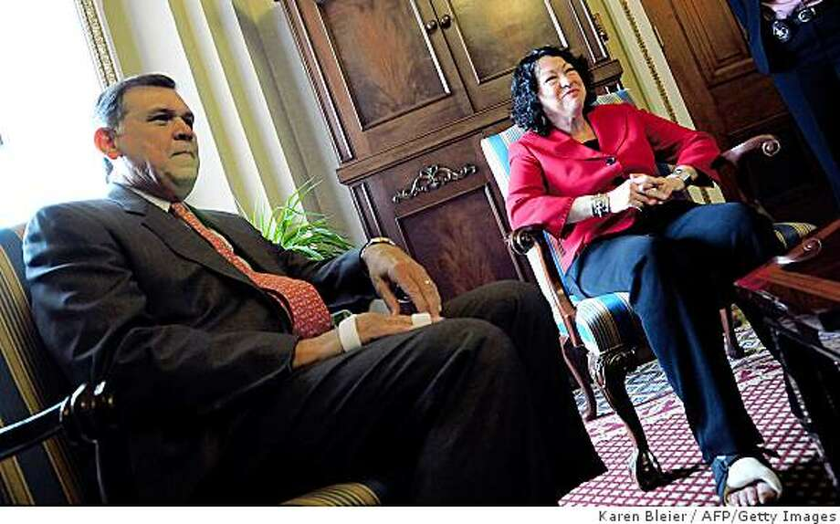 "US Supreme Court nominee Sonia Sotomayor meets with Sen. Mel Martinez, R-FL, on Capitol Hill on June 9 2009 in Washington, DC. Sotomayor fell and broke her ankle June 8; she sustained ""a small fracture"" to her right ankle at New York's LaGuardia Airport on her way to Washington, where she was scheduled to participate in a fresh round of meetings with senators who will vote on her nomination.Sotomayor, who would become the first woman of Hispanic origin to sit on the high court if confirmed by the Senate, has had a flurry of meetings with Senate leaders since she was nominated two weeks ago, as the Obama administration presses for a speedy confirmation.AFP PHOTO/Karen BLEIER (Photo credit should read KAREN BLEIER/AFP/Getty Images) Photo: Karen Bleier, AFP/Getty Images"