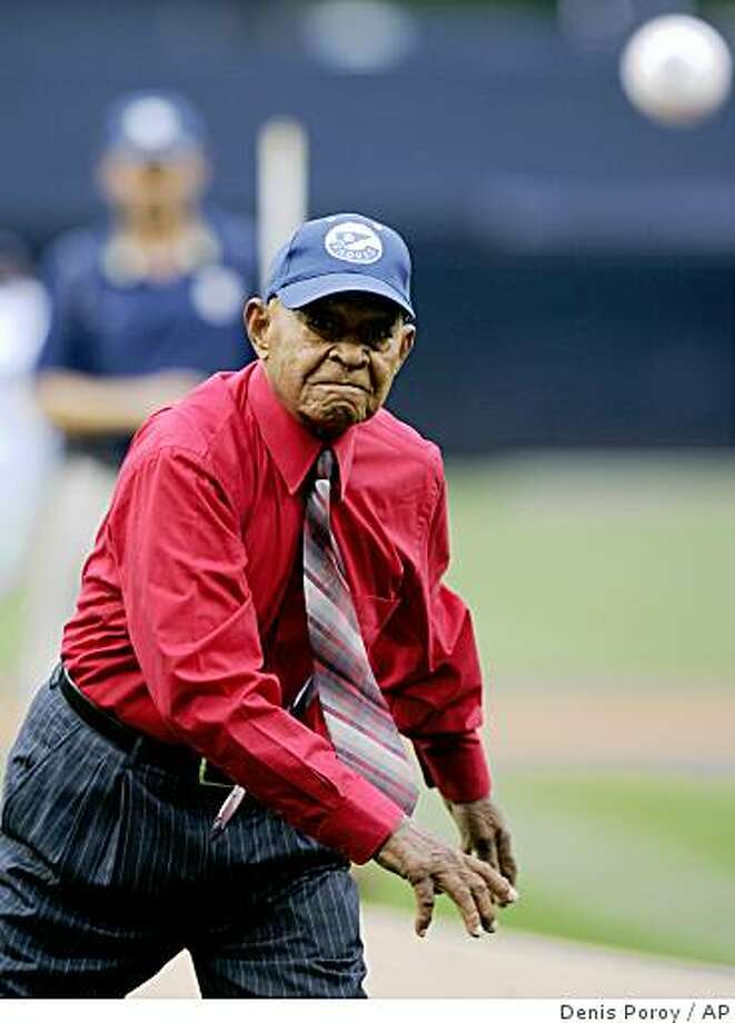 Puerto Rican Emilio Navarro, a former Negro Leagues player who is 103 years old, throws out the first pitch before a baseball game between the Oakland Athletics and the San Diego Padres  Saturday, June 20, 2009 in San Diego.  (AP Photo/Denis Poroy) Photo: Denis Poroy, AP