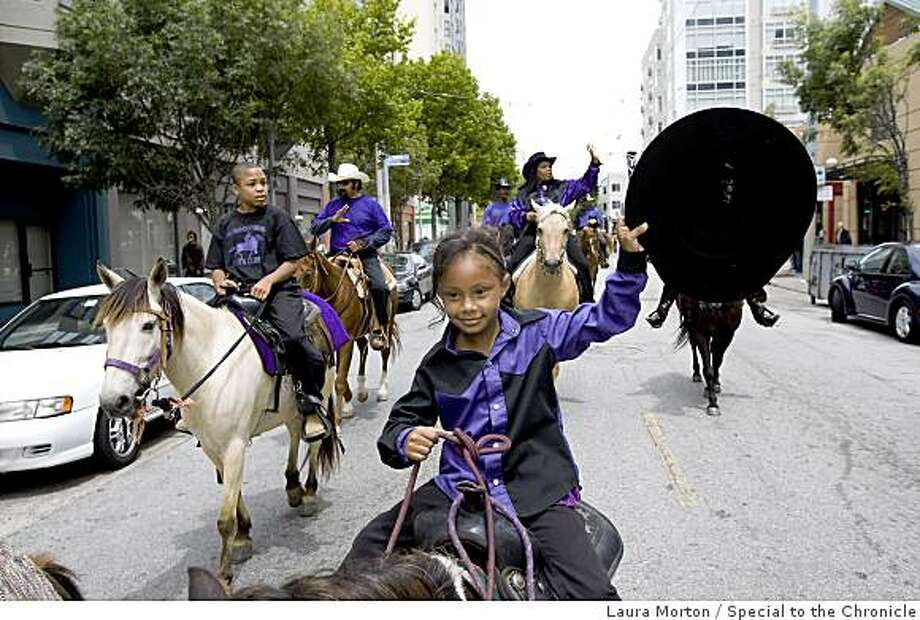 Aaliyah Arcos, 5, waves to the crowd as she rides the pony Oreo down Fillmore Street with other members of the Brotherhood Riders Youth Club during the San Francisco Juneteenth Parade on Saturday, June 20, 2009. Photo: Laura Morton, Special To The Chronicle