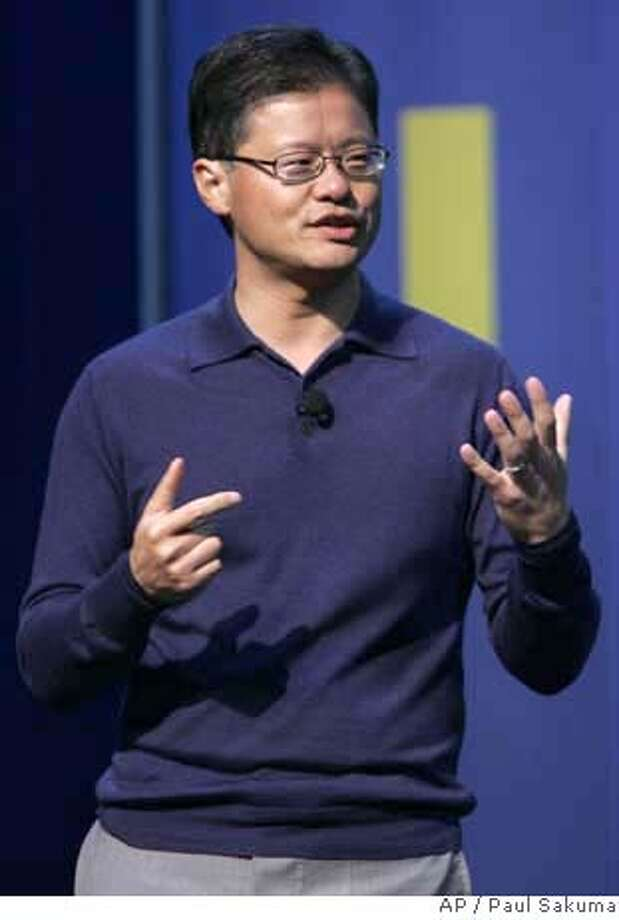 Yahoo CEO Jerry Yang gestures during his speech at the Consumer Electronics Show in Las Vegas, Jan. 6, 2008. Google Chief Executive Officer Eric Schmidt called Yang Friday to offer his help in repelling Microsoft, according to a report Sunday on The Wall Street Journal's Web site, which cited anonymous people familiar with the matter. (AP Photo/Paul Sakuma) JAN. 6, 2008 PHOTO. NOT A FILE. Photo: Paul Sakuma