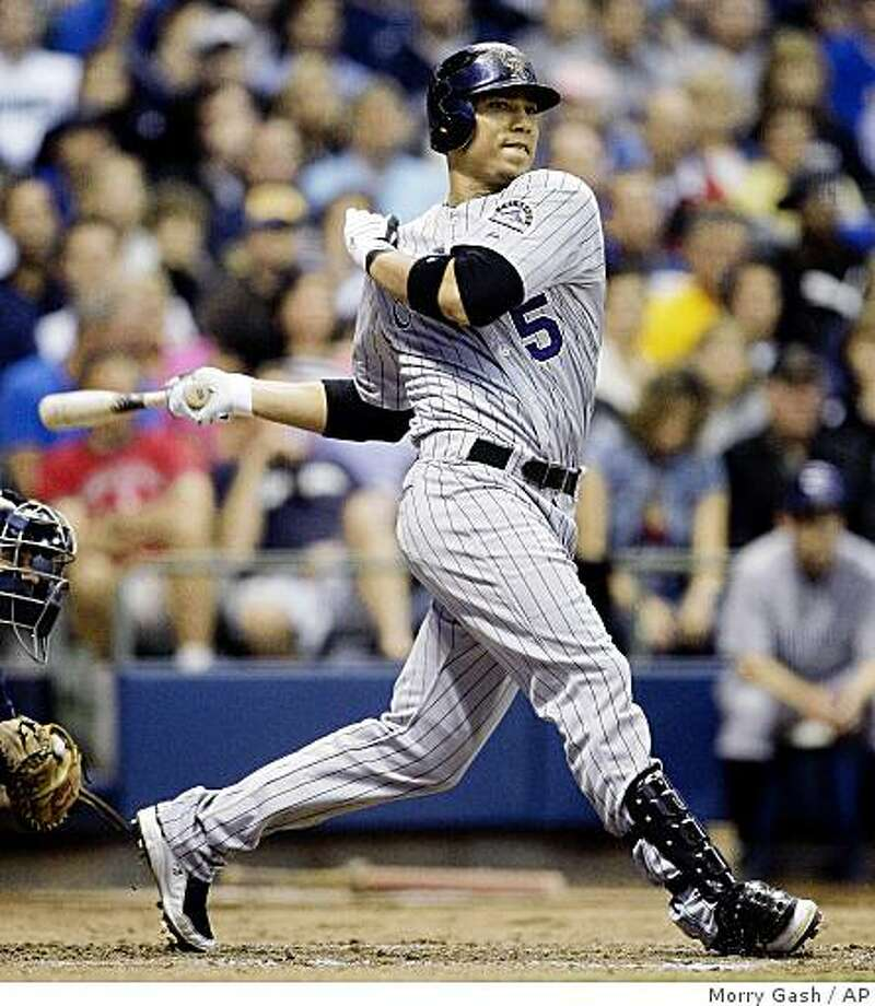 Colorado Rockies' Carlos Gonzalez hits a run-scoring double during the seventh inning of a baseball game against the Milwaukee Brewers Tuesday, June 9, 2009, in Milwaukee. (AP Photo/Morry Gash) Photo: Morry Gash, AP