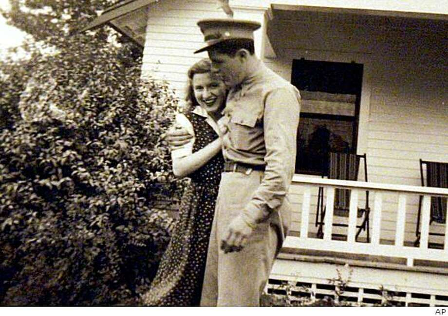FILE - This undated photo provided by the presidential campaign of then-Sen. Barack Obama, D-Ill., shows Obama's maternal grandparents, Stanley and Madelyn Dunham, in Cambridge, Mass., during World War II.  Dunham was a 26-year-old supply sergeant in the Army Air Force when the Allied invasion of Normandy at last began.  (AP Photo/Obama Presidential Campaign, File) ** FOR EDITORIAL USE ONLY, NO SALES ** Photo: AP