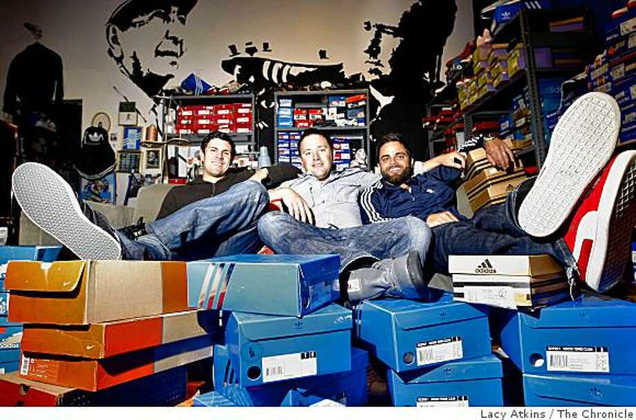 Nate Valentinen, Todd Palmerton and Demetrius Chapin-Rienzo  shop at the Harput's Market for vintage shoes, Monday June 15, 2009, San Francisco, Calif. Photo: Lacy Atkins, The Chronicle