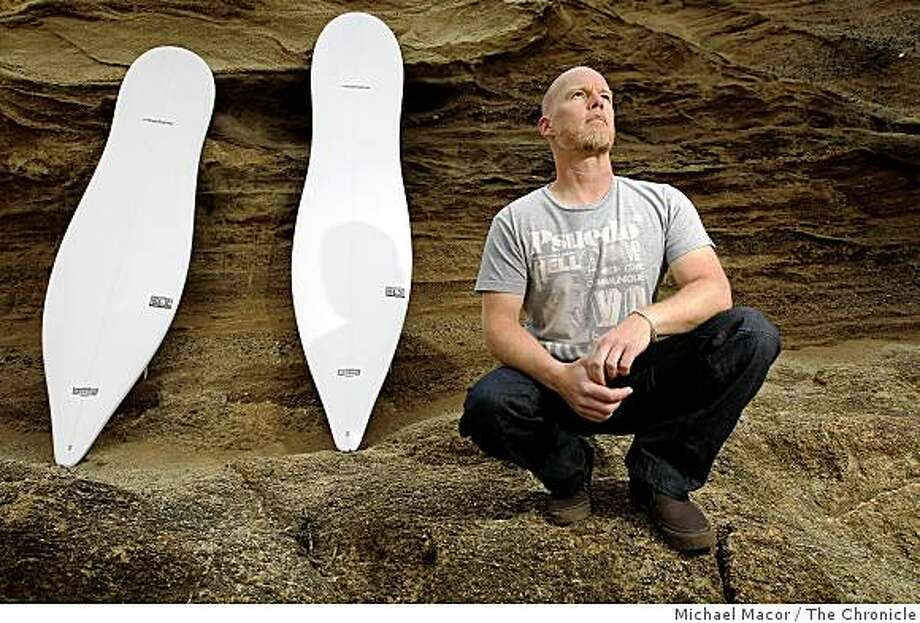 Local designer, Thomas Meyerhoffer with his latest creation, a new line of surfboards, along the beach in  Montara, Calif.  on Tuesday June 15, 2009. Photo: Michael Macor, The Chronicle