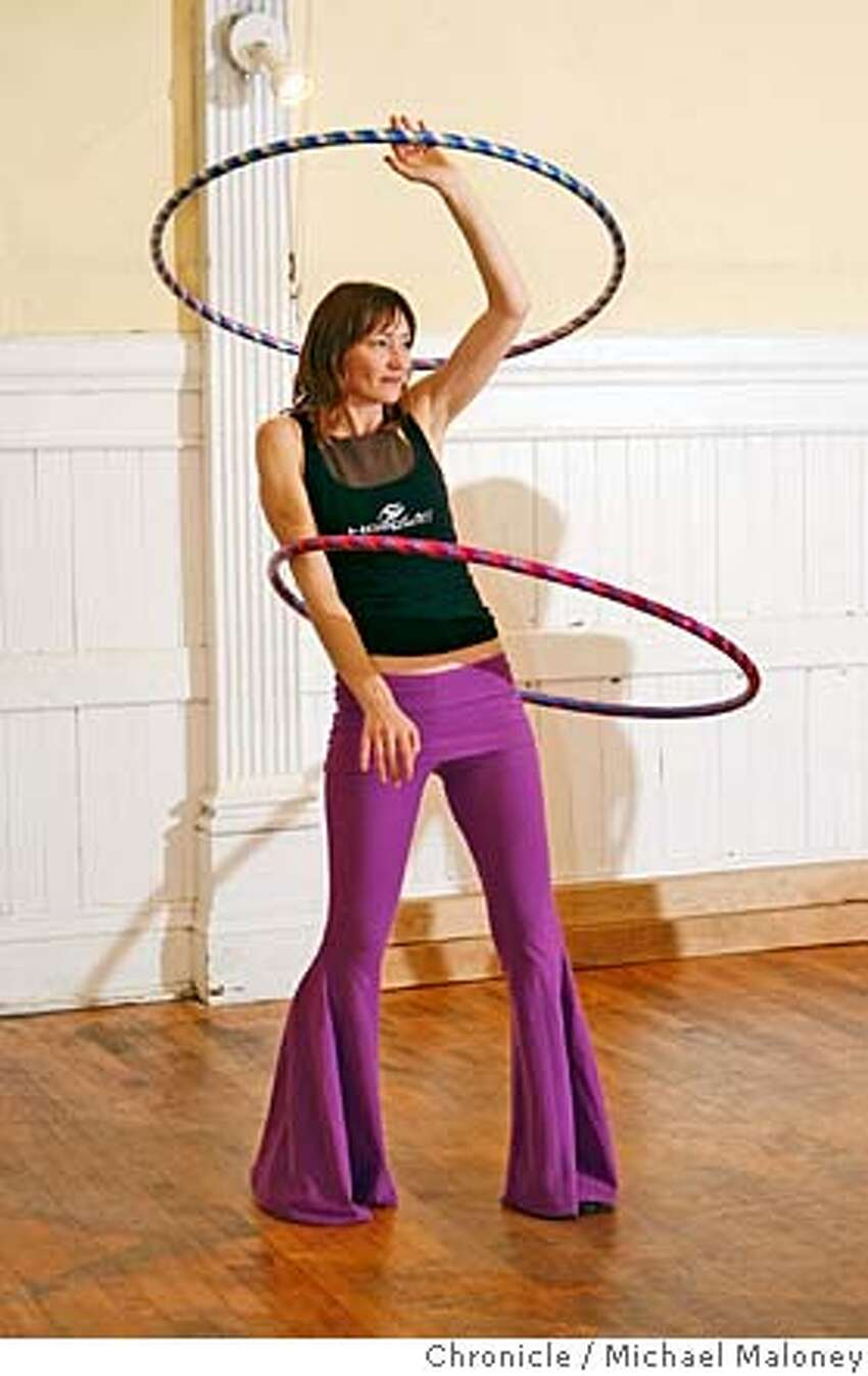 Claudia Graziano of San Francisco practices with two hoops. Hula hooping is making a comeback as an exercise and social craze. Christabel Zamor who calls herself