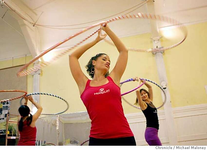 Christabel Zamor (center) and her Hoop Girl All-Stars practice their routines. Natasha Young of Berkeley at left, Claudia Graziano of SF at right. Hula hooping is making a comeback as an exercise and social craze. Christabel Zamor who calls herself
