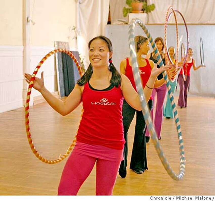 Natasha Young of Berkeley (foreground) and the Hoop Girl All-Stars practice their routines. Hula hooping is making a comeback as an exercise and social craze. Christabel Zamor who calls herself