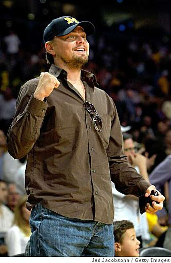 LOS ANGELES, CA - JUNE 07:  Leonardo DiCaprio cheers as he attends Game Two of the 2009 NBA Finals between the Los Angeles Lakers and the Orlando Magic at Staples Center on June 7, 2009 in Los Angeles, California. NOTE TO USER: User expressly acknowledges and agrees that, by downloading and or using this photograph, User is consenting to the terms and conditions of the Getty Images License Agreement.  (Photo by Jed Jacobsohn/Getty Images) Photo: Jed Jacobsohn, Getty Images