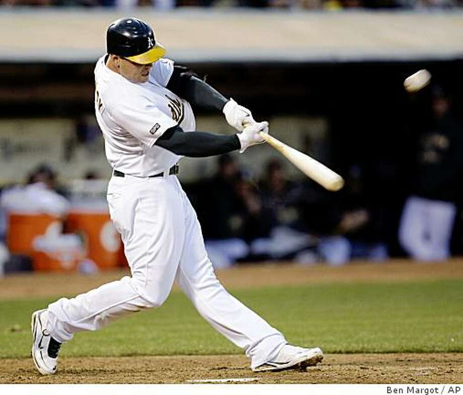 Oakland Athletics' Matt Holliday connects for a three-run home run off Baltimore Orioles' Mark Hendrickson in the fifth inning of a baseball game Friday, June 5, 2009, in Oakland, Calif. (AP Photo/Ben Margot) Photo: Ben Margot, AP