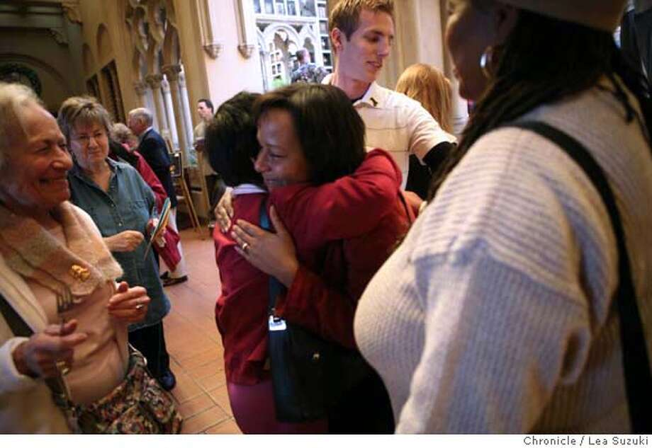 (center with face toward camera) Jennifer Rodriguez, the mother of the shooting victim, gets a hug from a well wisher at the Chapel of the Chimes during A Celebration of Music, a fundraiser for Christopher Rodriguez on Sunday February 10, 2008. Lea Suzuki/ The Chronicle �2007, San Francisco Chronicle  MANDATORY CREDIT FOR PHOTOG AND SAN FRANCISCO CHRONICLE/NO SALES-MAGS OUT Photo: Lea Suzuki
