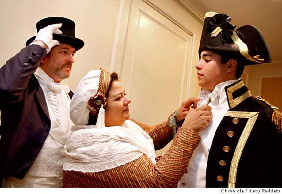 "William Solomon, left, adjusts his hat as Virginia Solomon, his wife, center, spruces up the collar of David Solomon, right, their son, at the Jane Austen Society, North America meeting for a tea, then a screening of the new PBS Masterpiece film based on ""Pride and Prejudice."" The members of the society enjoy period costumes and share a passion for Jane Austen novels. MANDATORY CREDIT FOR PHOTOG AND SAN FRANCISCO CHRONICLE/NO SALES-MAGS OUT Photo: KATY RADDATZ"