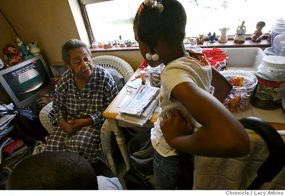 Eris White, 83, talks with a young girl as she buys some candy, March 29, 2007 at her home in the Sunnydale Projects in Visitation Valley of San Francisco, Ca. She is known as grandma that runs the candy house. Where people come to buy candy, soda's, and cigarettes. (Lacy Atkins / San Francisco Chronicle) Photo: Lacy Atkins