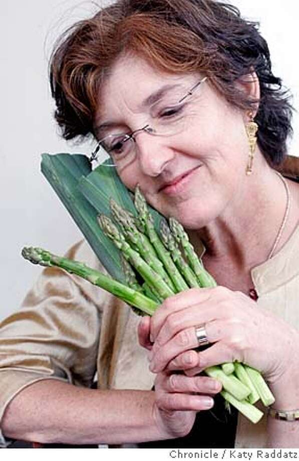 """KINGSOLVER27_045_RAD.jpg SHOWN: Barbara Kingsolver poses for a portrait at Zuni Cafe with a bunch of local vegetables from the kitchen: asparagus, fava beans, and leeks. Barbara Kingsolver and her husband Steven L. Hopps enjoyed lunch at Zuni Cafe in San FRancisco. Barbara Kingsolver has just published a book called """"Animal, Vegetable, Miracle A Year of Food Life."""" These pictures were made in San Francisco, CA. on Tuesday, May 15, 2007.  (Katy RaddatzThe Chronicle)  **Barbara Kingsolver, Steven L. Hopps Mandatory credit for the photographer and the San Francisco Chronicle. No sales; mags out. Photo: Katy Raddatz"""