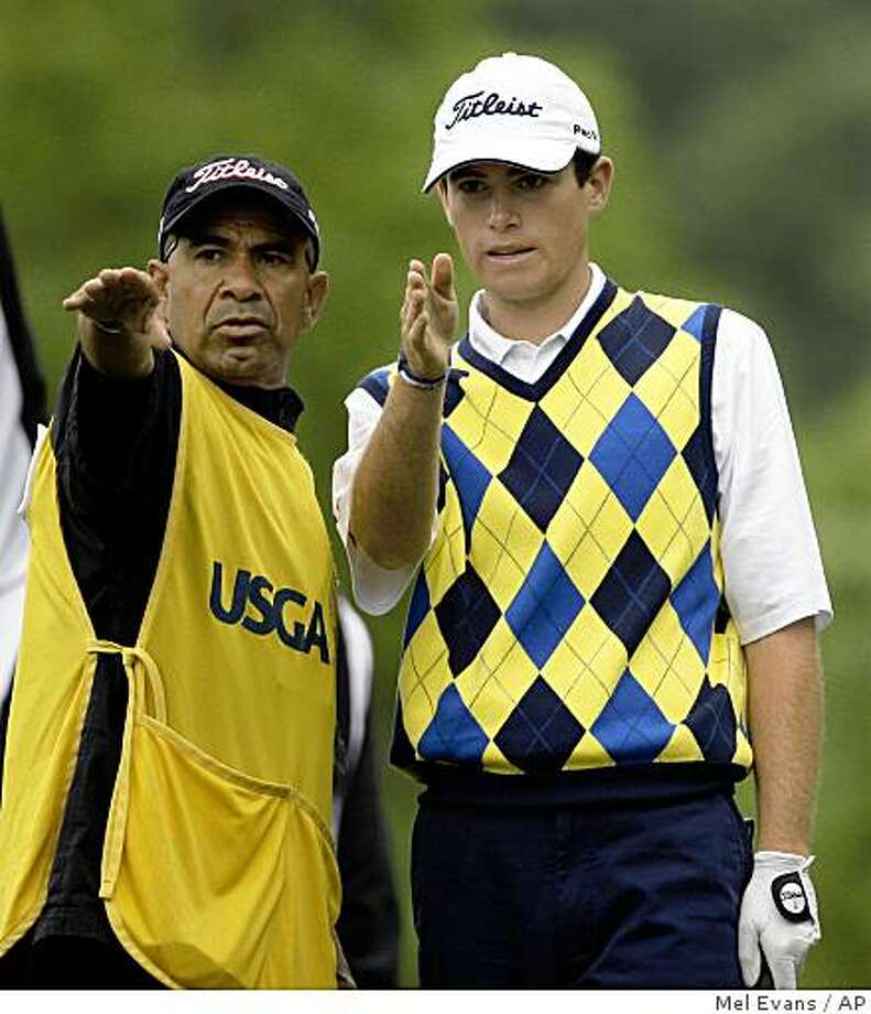 Amateur Drew Weaver, right, discusses his tee shot on the 13th hole with his caddie C. Damian Velaquez during the first round of the U.S. Open Golf Championship at Bethpage State Park's Black Course in Farmingdale, N.Y., Friday, June 19, 2009. Play was suspended on Thursday because of inclement weather. (AP Photo/Mel Evans) Photo: Mel Evans, AP