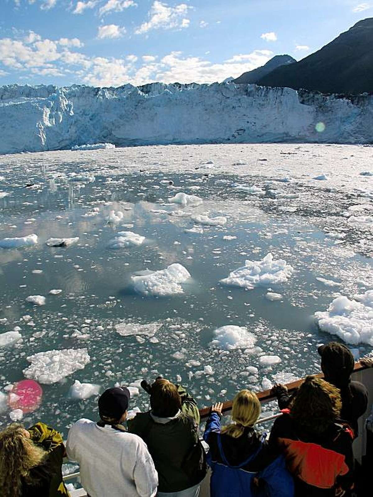 TRAVEL ALASKA GLACIERS -- Passengers aboard Spirit of Columbia admire the Harvard Glacier at the end of the icy College Fjord during a small-ship cruise of Prince William Sound in Alaska. Spud Hilton / The Chronicle travel_alaska228.jpg