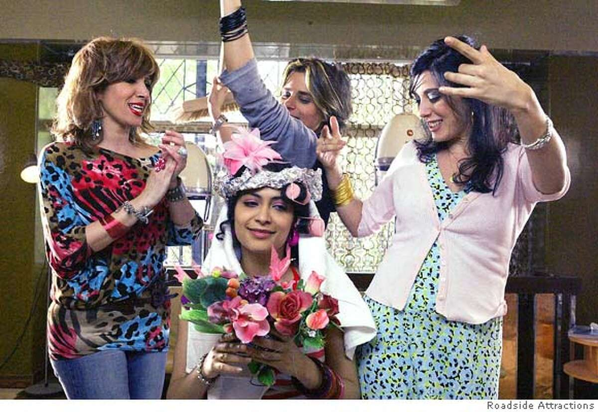 """In this undated photo released by Nadine Labaki's office, Director Nadine Labaki, right, is seen playing the role of Layal with other actresses in the movie """"Caramel,"""" in Beirut, Lebanon. In a country where most local film productions tend to focus on war and politics, """"Caramel,"""" a movie by director Nadine Labaki, digs into the lives of five Lebanese women struggling to deal with heartbreak, sexuality and getting old. (AP Photo/HO)"""