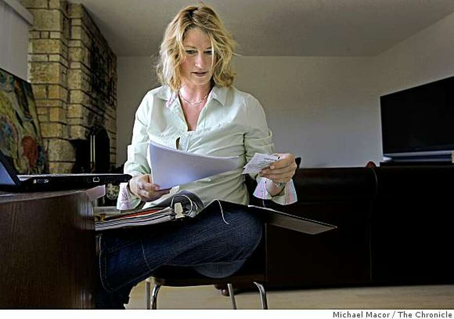 43-year-old Shannon Fee sits in her apartment in Alameda, Calif., on June 19, 2009. Fee has been out of work for than a year. Photo: Michael Macor, The Chronicle